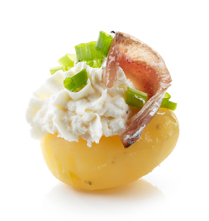 cream cheese: boiled potato decorated with cream cheese, anchovy and spring onions isolated on white background Stock Photo