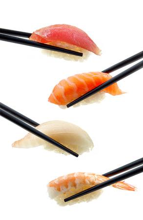 白い背景に分離された様々 な寿司 写真素材