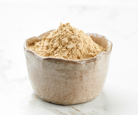 maca: bowl of maca powder on kitchen table