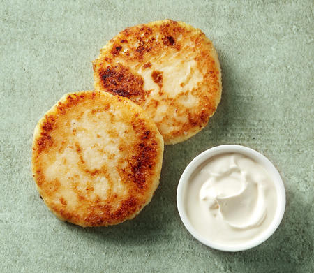 cream cheese: freshly baked cottage cheese pancakes with sour cream, top view