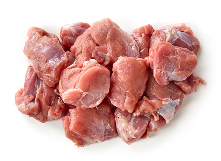 heap of fresh raw meat pieces isolated on white background, top view Reklamní fotografie
