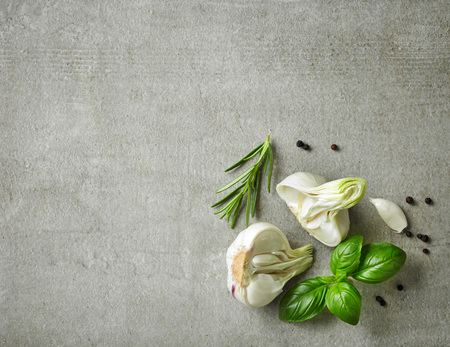 green plants: fresh herbs and spices on gray stone background, top view Stock Photo