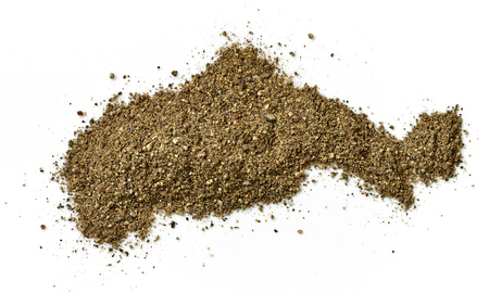 pepe nero: heap of ground black pepper isolated on white background, top view