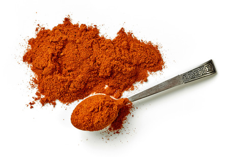 chilies: heap of chili powder isolated on white background, top view
