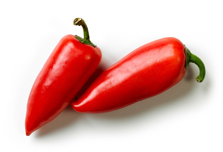 two on top: two fresh sweet peppers isolated on white background, top view