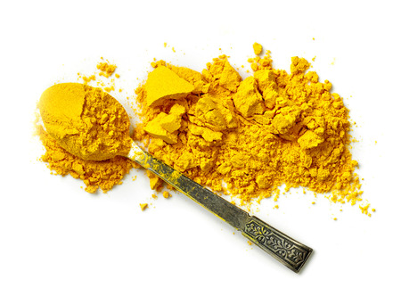 curcuma: heap of curcuma powder isolated on white background, top view