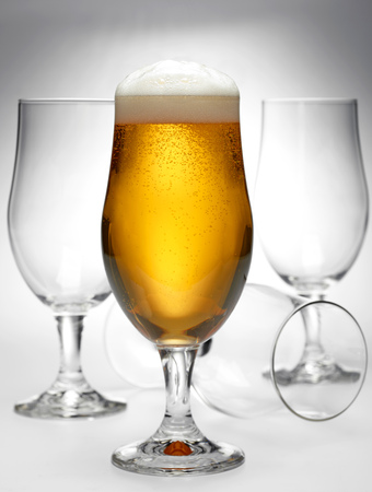 un bottled: glass of beer and empty glasses Stock Photo