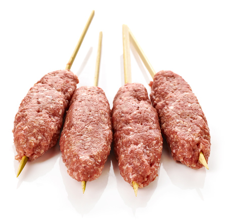 meat skewers: fresh raw minced meat skewers kebabs isolated on white background