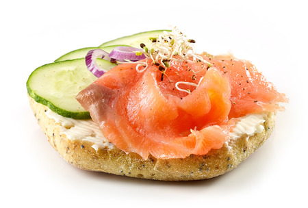 smoked: bread with smoked salmon and cucumber isolated on white background Stock Photo