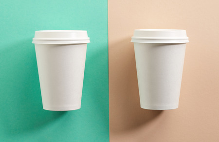 take away: two white take away coffee cups on colorful paper background