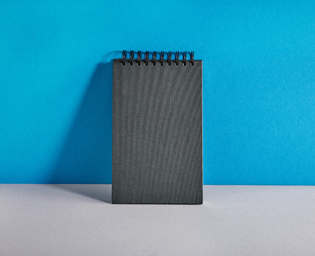 notebook paper background: black notebook on colorful paper background