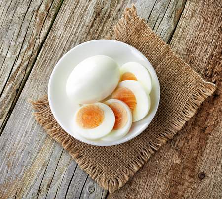 boiled egg on white plate, top view