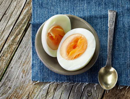 table top: boiled egg on wooden table, top view Stock Photo