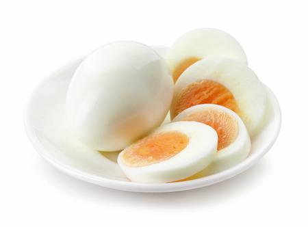sliced egg on white plate isolated
