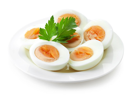 plate of freshly boiled eggs isolated on white background
