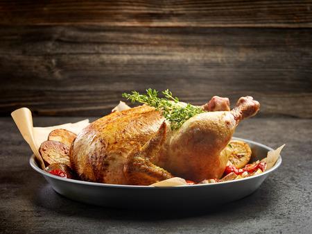 whole roasted chicken on dark kitchen table