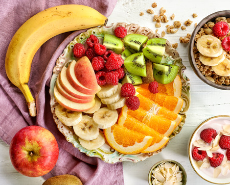 fruit plate: plate of fruit pieces and berries, top view