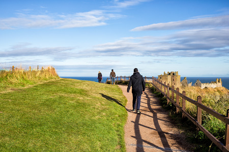 tourists going to see scottish Dunnotar Castle