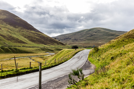 highland: Road in Scotland, hills and clouds