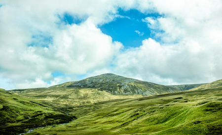 Scotland landscape with hills and sky Stock Photo