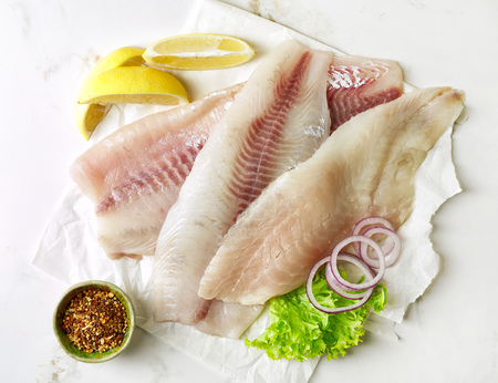 fillets: fresh raw bream and seabass fish fillets, top view Stock Photo