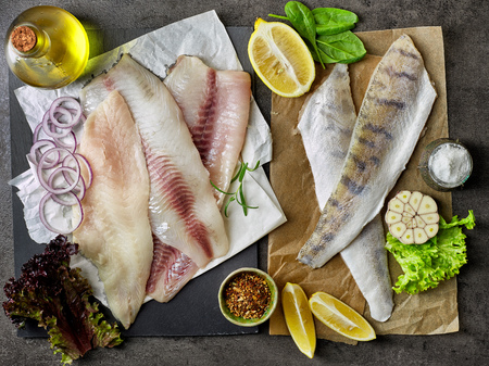 fresh raw bream, seabass and perch fish fillets, top view