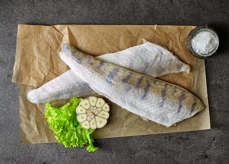 fresh fish: fresh raw perch fish fillets on baking paper, top view