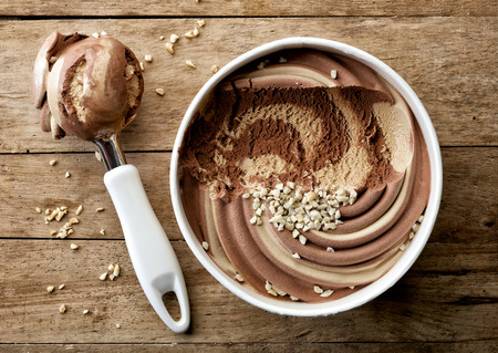 chocolate and peanut ice cream on wooden table, top view