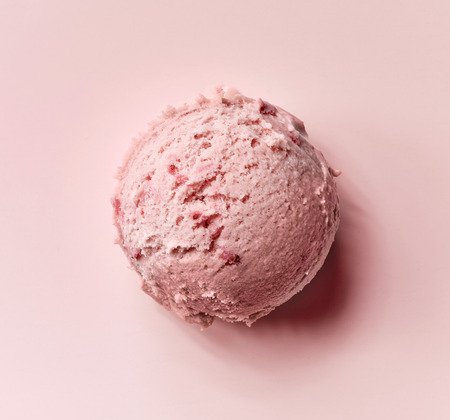 strawberry ice cream ball on pink background, top view