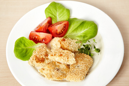 free plate: gluten free roasted fish fillet covered with sesame seeds on white plate Stock Photo