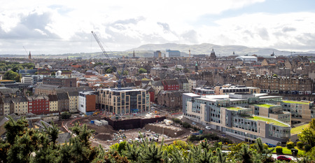 Edinburgh, ScotlandUK - SEPTEMBER 29, 2016: Construction work in Edinburgh, panoramic view of city from Holyrood park