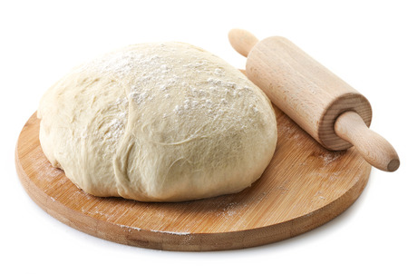 fresh raw dough for pizza or bread baking on wooden cutting board isolated on white background Stockfoto