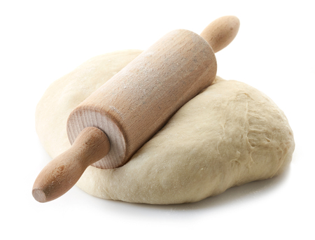 fresh dough and rolling pin isolated on white background