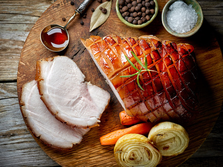 jamon: roasted pork slices on rustic wooden table, top view
