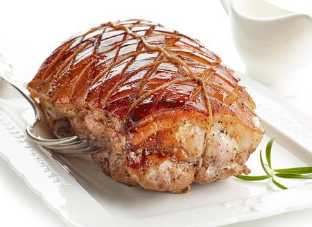 closeup of roasted pork on white plate