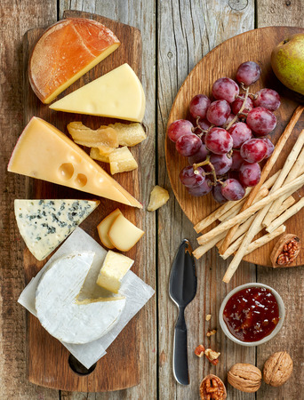 delicatessen: various types of cheese and fruits, top view Stock Photo