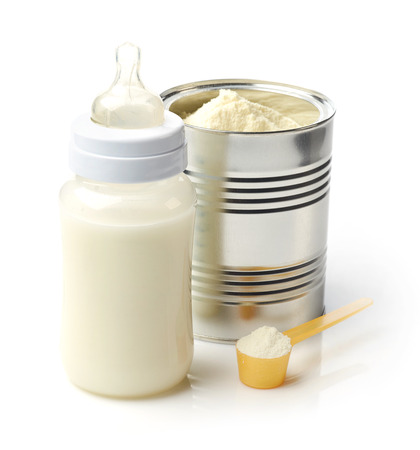 Baby milk bottle and powdered milk isolated on white background Stock Photo