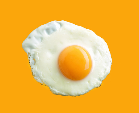 fried: fried egg on yellow background, top view