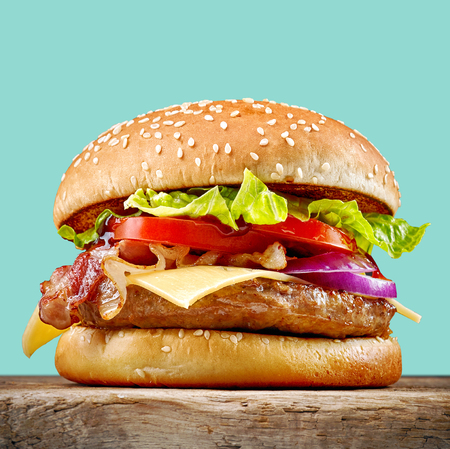 fresh tasty burger on wooden table Foto de archivo