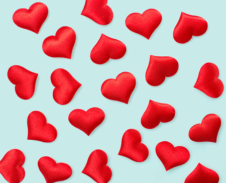 red hearts background on blue background