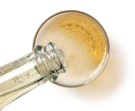 champagne pouring into glass, top view