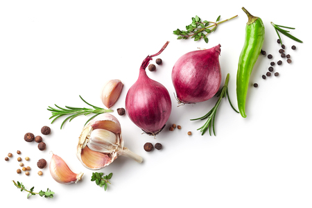 Diagonal composition of red onions, garlic and various spices isolated on white background, top view