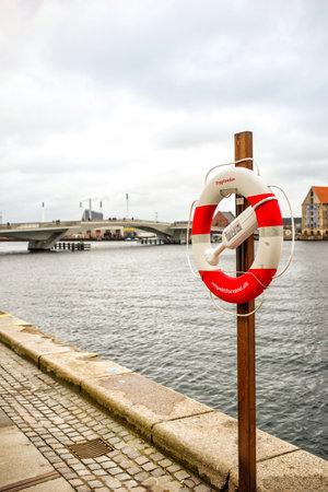 Copenhagen, Denmark - MARCH 29, 2017: Life belt on Havnepromenade