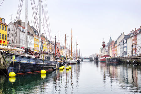 march 17th: Copenhagen, Denmark - MARCH 30, 2017: Nyhavn is a 17th-century waterfront, canal and entertainment district in Copenhagen, Denmark.