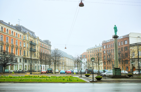 Copenhagen, Denmark - MARCH 30, 2017: H.C.Andersens blvd. in front of Ny Carlsberg Glyptotek in a rainy day