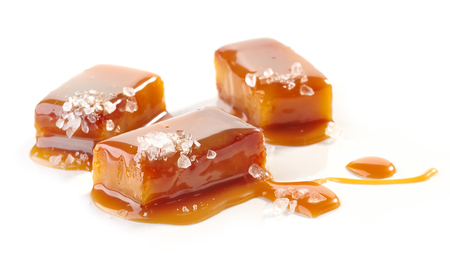 homemade salted caramel pieces isolated on white background Standard-Bild