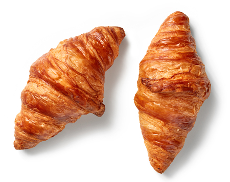freshly baked croissants isolated on white background, top view Standard-Bild