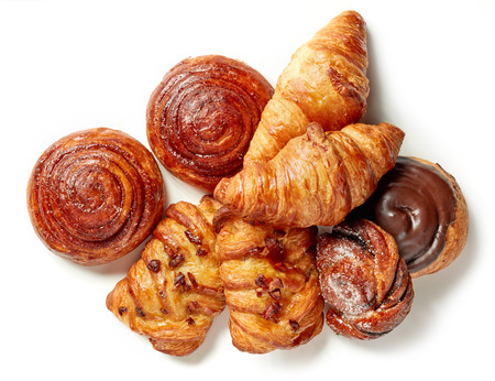 freshly baked pastries isolated on white background, top view Stockfoto