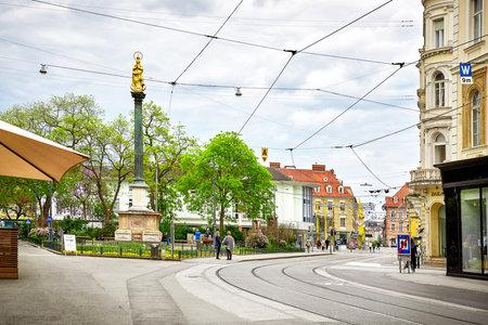 Graz, Austria - MAY 7, 2017: Street view of Graz, monument Mariensäule - Am Eisernen Tor Editorial