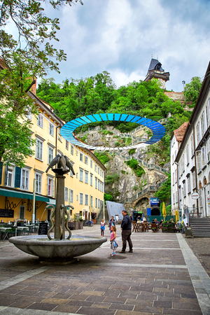 Graz, Austria - MAY 7, 2017: View of the Schlossbergplatz square in austrian Graz which is connected by steep staircase to the Schlossberg castle.